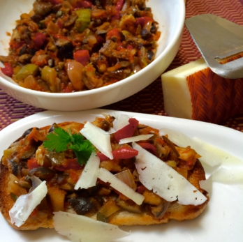 Making ahead has its advantages: it allows the flavors to blend for better taste AND it makes for an easy lunch: here, I toasted a few slices of bread, topped them with cooled down caponata, and shaved some Manchego cheese on top. Priceless!