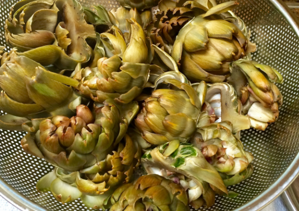 Drain the artichokes into a colander, set over a large bowl to save the liquid for artichoke soup!