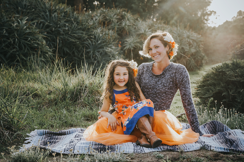 Mother and daughter on a blanket at Wilder Ranch.