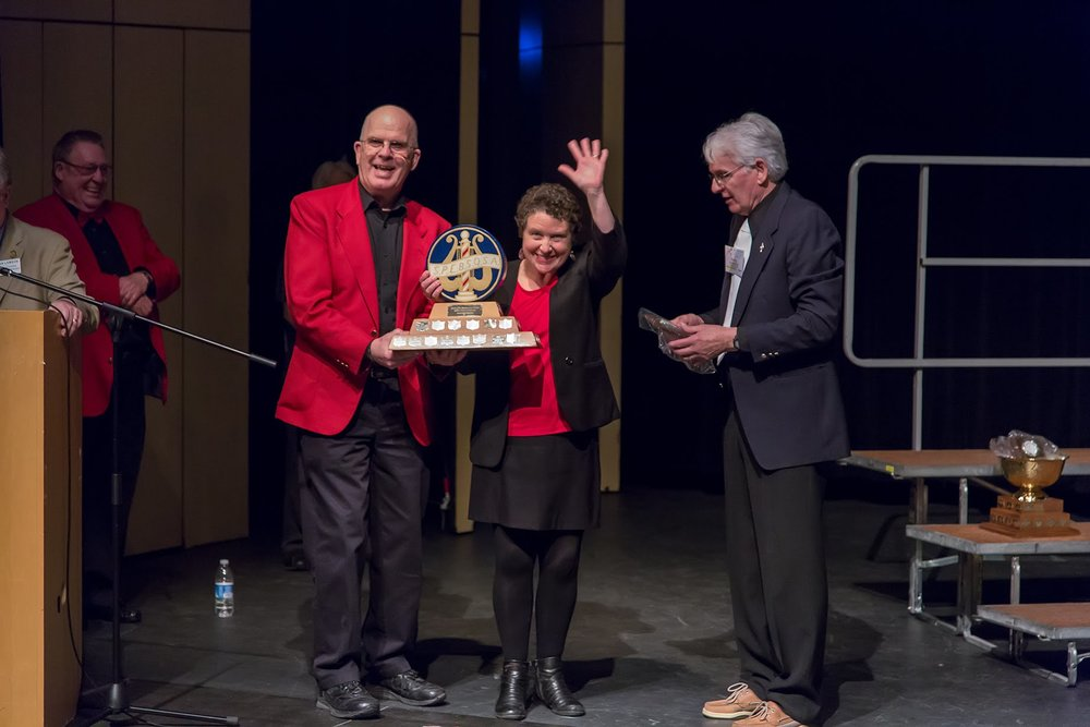 André Welland (President of Men of Fundy) and Janet Kidd (Director) receiving one of the trophies won by Men of Fundy at the recent Sunrise Division annual contest.