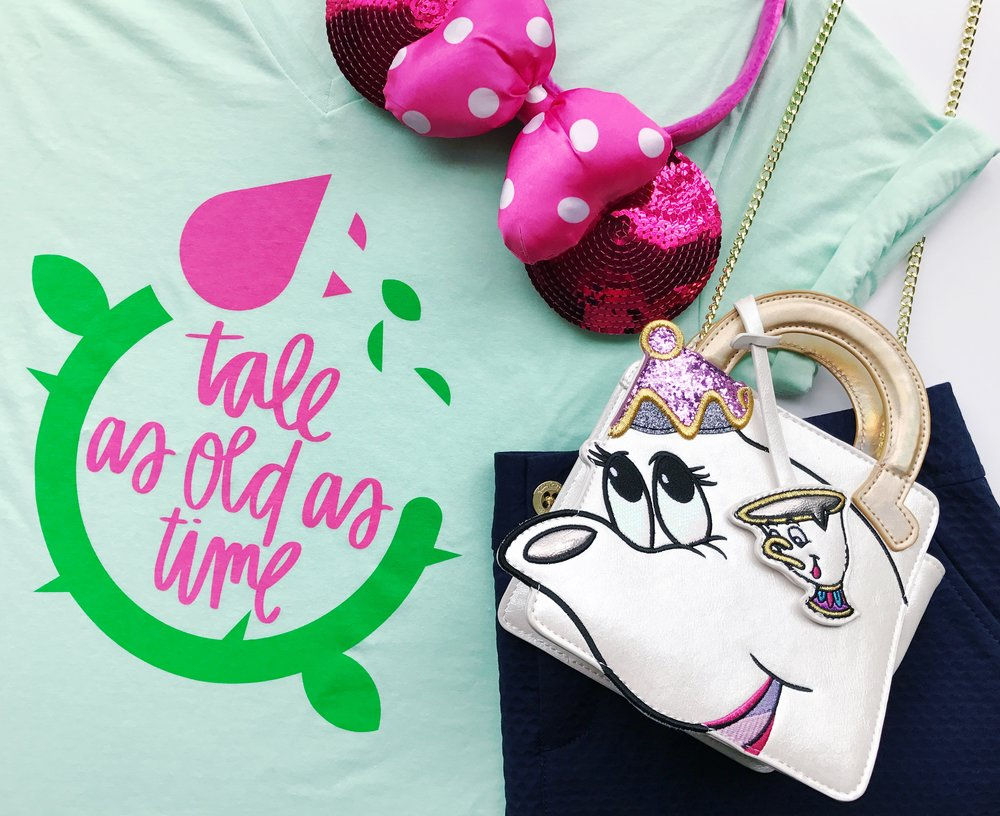 After the race we went for brunch at 1900 Park Fare and my look was also Beauty and the Beast inspired.   Tale as Old as Time tee from Happily Ever Tees paired with a Navy Skort from Lilly Pulitzer. My ears are sold in the Disney Parks, and the bag is from Danielle Nicole.
