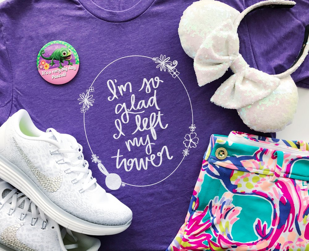 I'm So Glad I Left My Tower tee from Happily Ever Tees paired with shorts from Lilly Pulitzer. My button is from Parkbound, ears from Bibbidi Bobbid Brooke and shoes from Bibbidi Bobbidi Bling.
