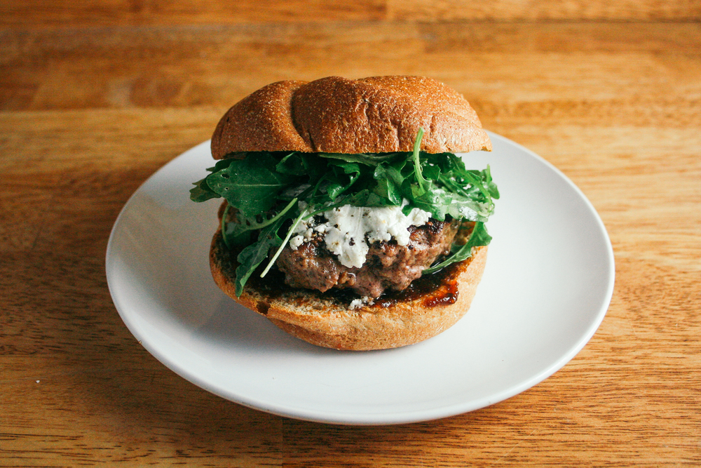 Sweet and Savory Burger with Fig Jam, Goat Cheese, and Arugula