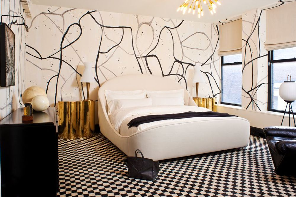 Artful hand–painted wall covering in a guest bedroom.