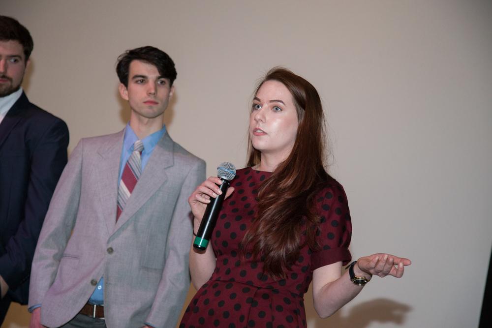 Production Designer Katy Sullivan answers questions while Music Composer Daniel Eggert listens.