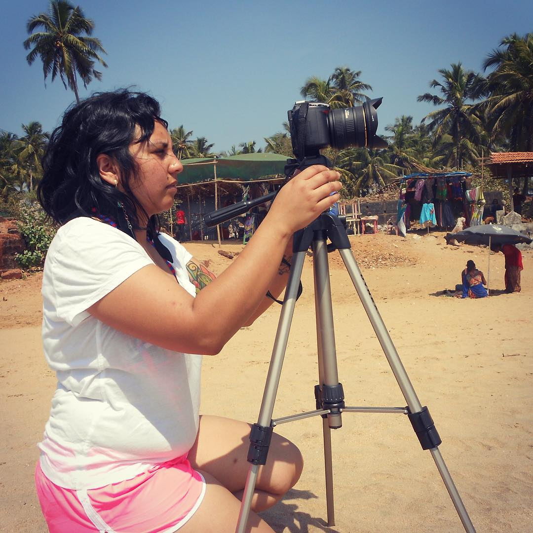 Check out our #director and #editor in action! @saywhatfoo is all about those #timelapse footage. She is seen here getting her #Nikon ready on #anjunabeach   To see the magic that she created, visit WeAreGazillionStong.org and search the film title, YOU FOLLOW: a search for one's past.     #youfollowthefilm #womeninfilm #cameras #films #documentaryfilm #pinkshorts #filipina #indian #beach #sand #tourist #filmmaking #likeaboss #palmtrees #internationalfilm #movies