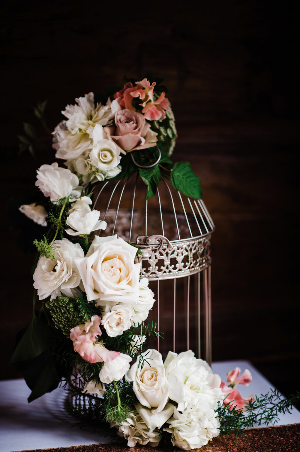 Bird cage with floral o+d.JPG