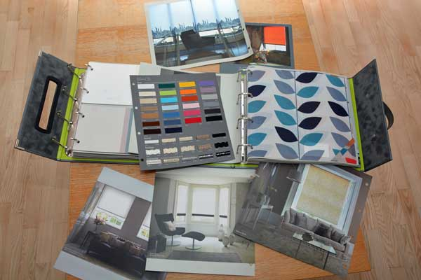 A collection of fabric samples and brochures