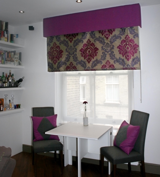 Roman blind with ornate fabric, and purple pelmet