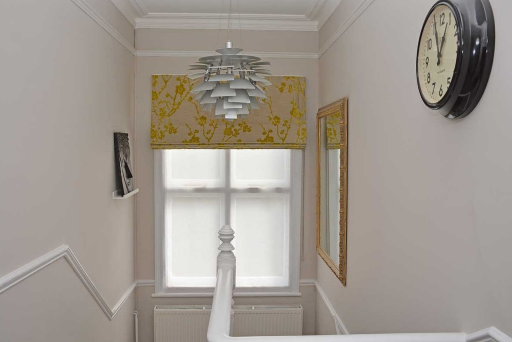 Roman blind with mustard yellow flower print fabric