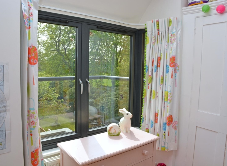 Children's curtains with bright-green pom-poms