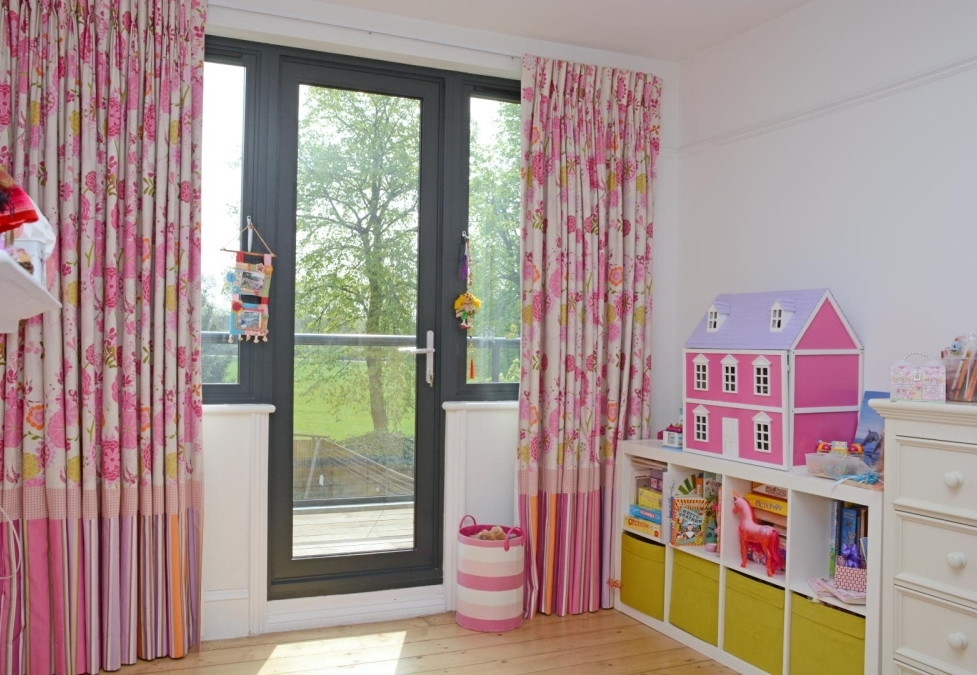 Bespoke curtains created with mixed pink, grey and yellow fabric