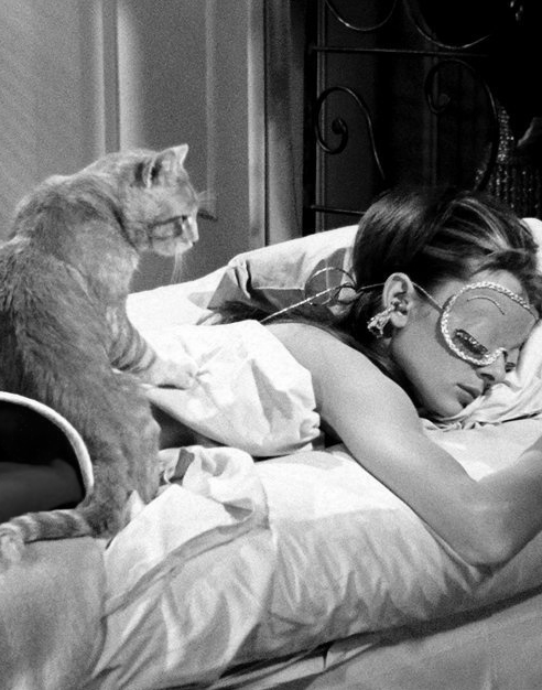 The one and only Audrey Hepburn as Holly Golightly, with Cat