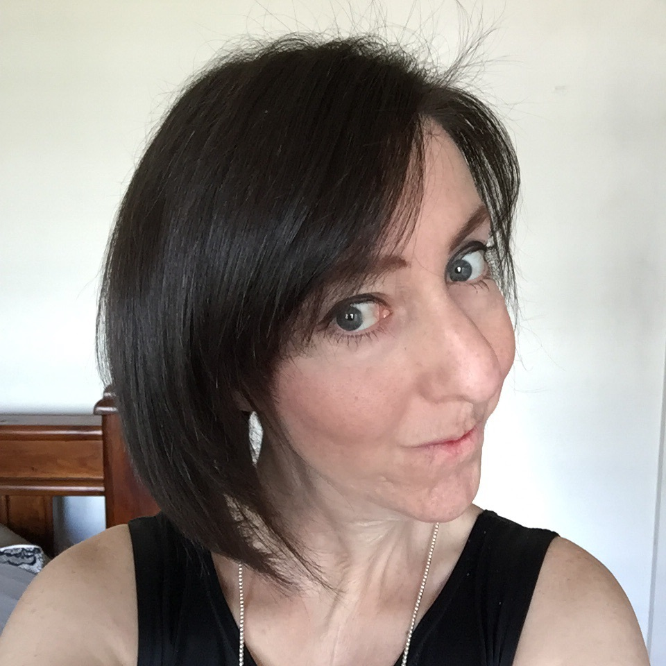 A recent selfie with my hair flipped to show off more of the left-hand side of my face than I'm usually comfortable with. Yes, the Emo Fringe was perfect for me as a late teen.