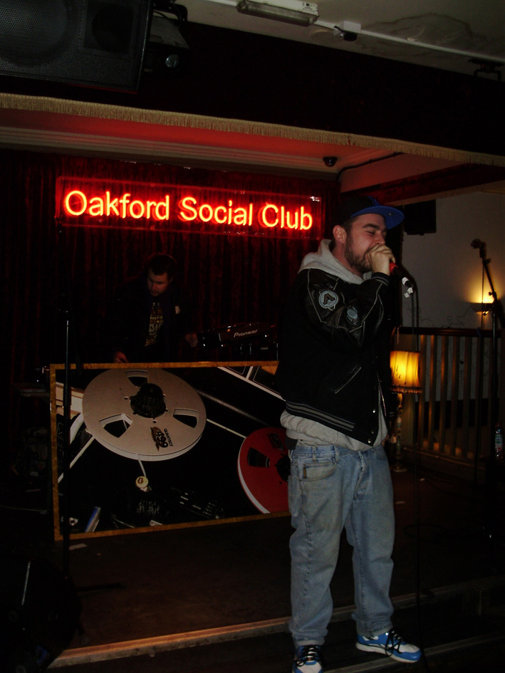 Going Postal: Dj Ivan6, Oliver Sudden & Menace.    Picture above taken last week at  Going Postal , Oakford Social Club, Rdg.  A Holdin' Court showcase with  Dj Ivan6  on the turntables and  Oliver Sudden  on the Mic with further support from a local-to-reading rapper named  Menace .  You can catch them all at Holdin' Court next weekend (May 29th) - Dj Ivan6 is a resident, Oliver Sudden is the nights Guest Host and Menance will hopefully be entering for the Open-Mic.