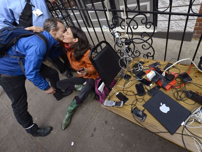 New Yorkers charge smartphones and tablets post-hurricane Sandy.