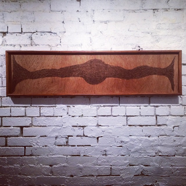 Unlimited Potential  (2015)  Wood Burning on Pine Wood Hand Made Frame using Aged Reclaimed Wood 49 in x 2½ in x 12 ½ in  SOLD