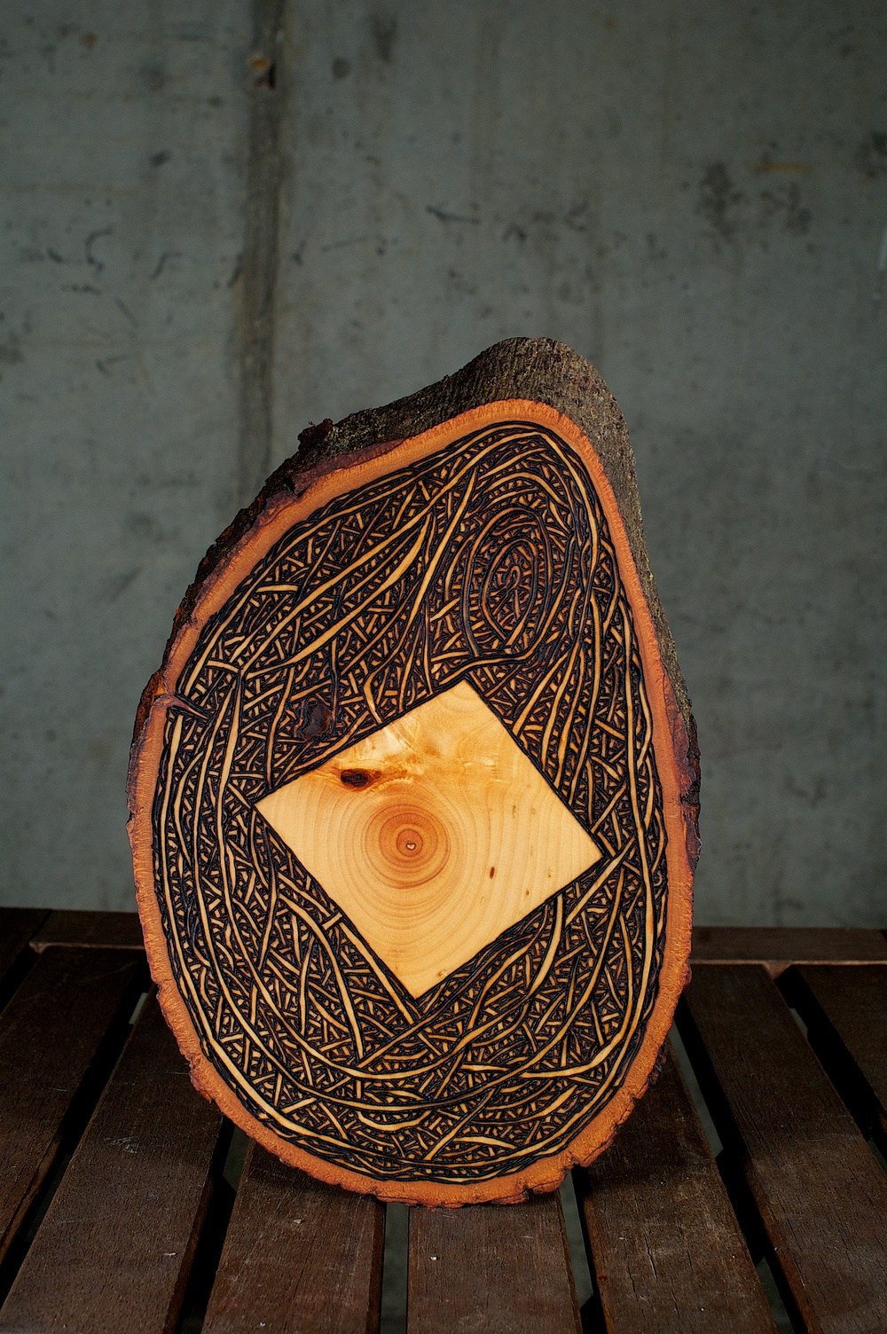 Outside The Box   (2015) Wood Burning On Bass Wood Bark Slab 9 in x 1 in x 6 in