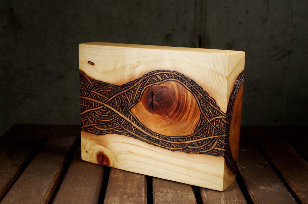 The Eye    (2015)   Wood Burning On Red Wood   7 in x 1 ½ in x 6 in   $150.00    For Inquiry Email bzartsgallery@gmail.com
