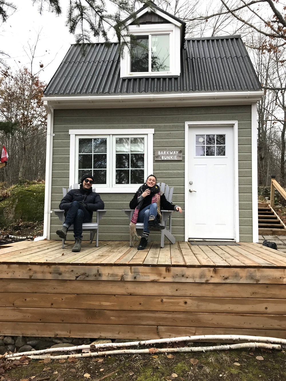 Yvan and I sitting in front of our new home!