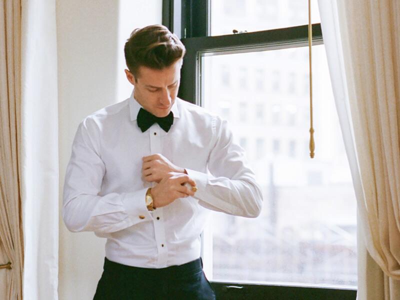 Ellens-Online-Tux-Rental-groom-at-window.jpg