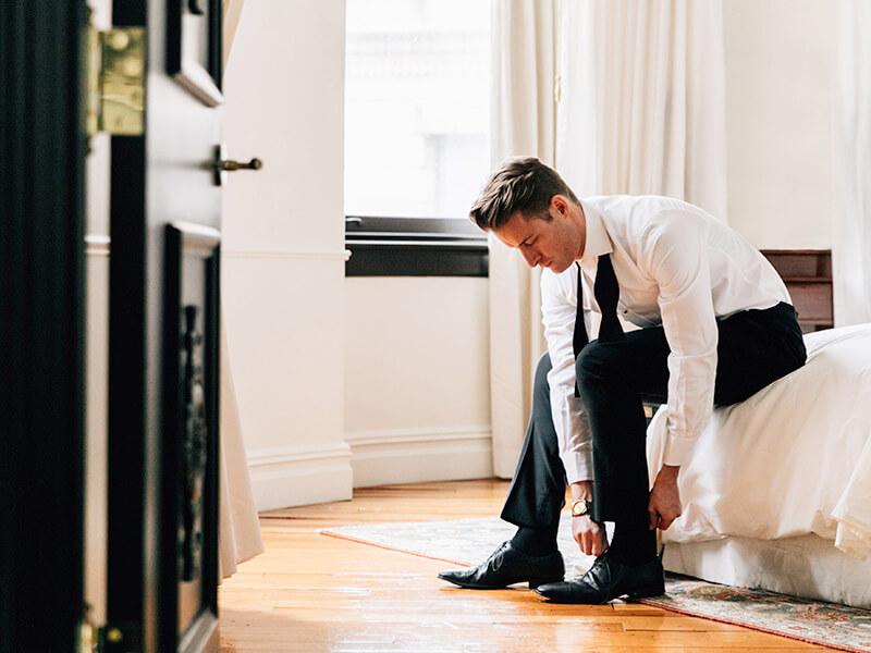 Ellens-Online-Tux-Rental-groom-in-doorway.jpg