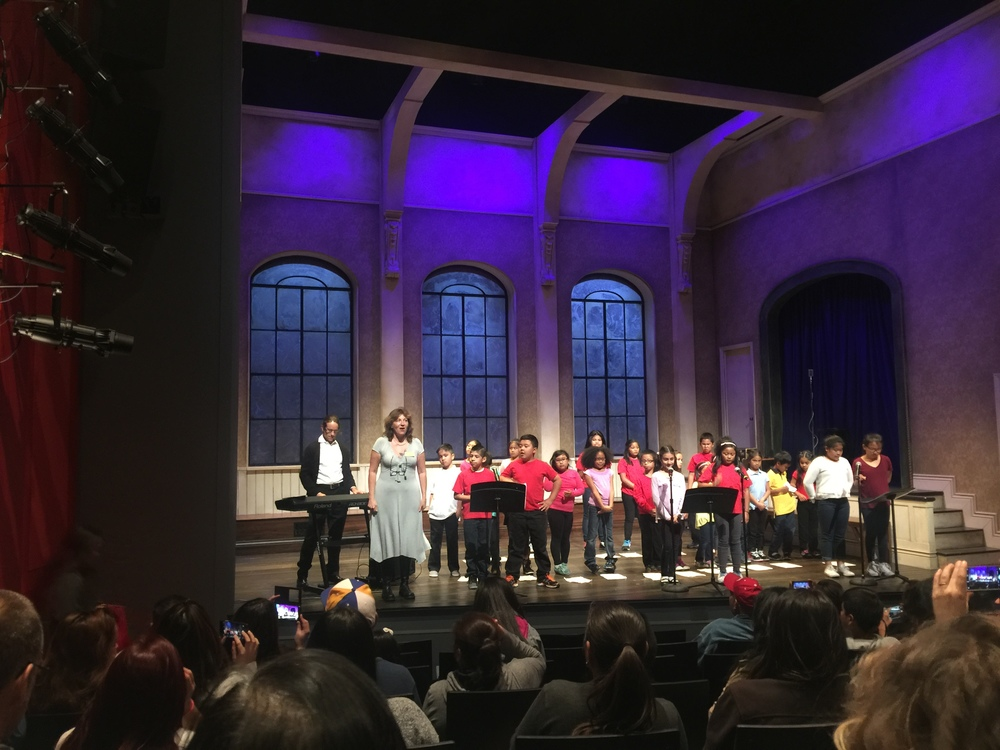 Fourth and Fifth Graders from the Bessie Carmichael Elementary School perform their teacher Peter Sroka's composition about Philippines history at the American Conservatory Theater's Strand Theater. Sroka is performing on the keyboard on the left.   Image:   Sarah Lai Stirland
