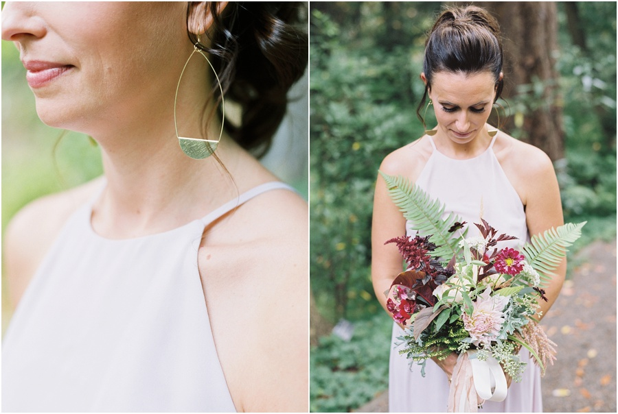 Bridesmaid in blush dress, gold handmade earrings holding bouquet.