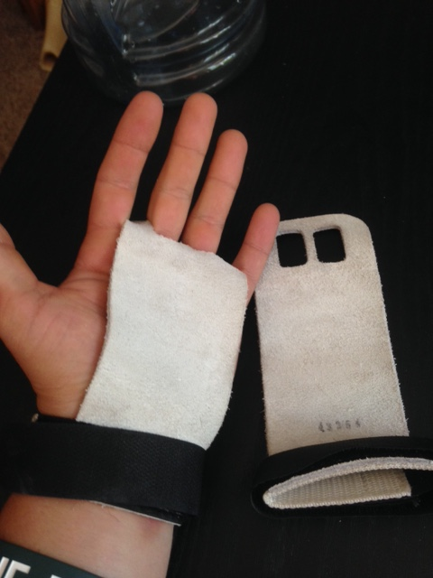 Gymnastics grips are they way to go! They take a bit of getting used to, but are well worth the lack of tears in your hands. Visit  http://www.roguefitness.com/rogue-v2-gymnastic-grips  to get yourself a pair.