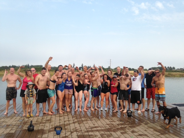 Part of the Swim WOD crew showing their best land swimming form!
