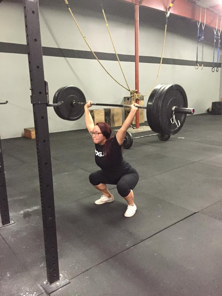 Rhi possibly closing her eyes on a heavy Overhead Squat, not exactly recommended in the 23 points of performance below! :)