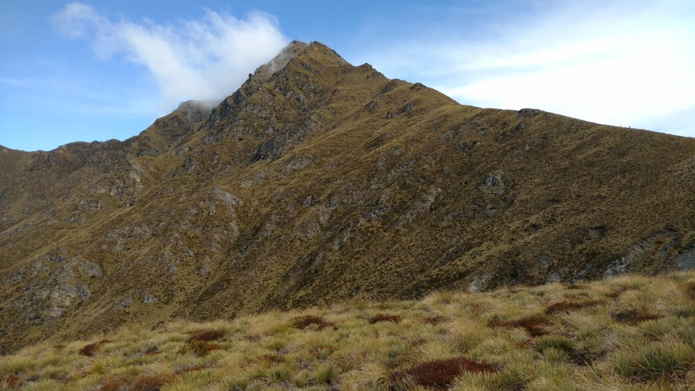 Specks (people) hiking the ridgeline of Ben Lomond