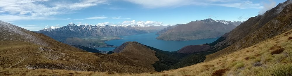 Panorama trail view of Queenstown, The Remarkables and Lake Wakatipu