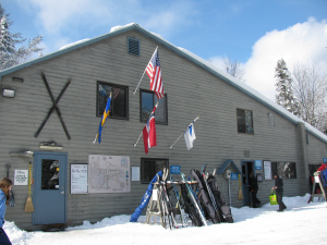 Lapland Lake's eclectic row of flags reflects the international mindset of its founder, Olavi Hirvonen.