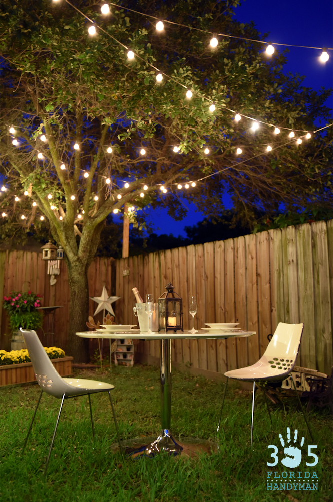 Romantic Outdoor Dining Under Bistro Lighting