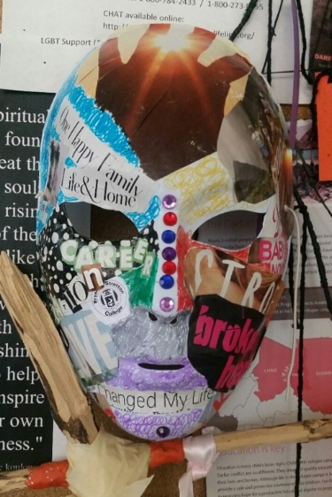 "PSYC 120 student work representing the ""masks"" we wear in life and how assumptions and stigma can affect the individual."