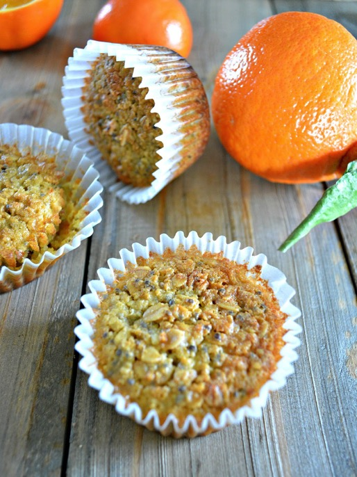 Gluten free orange muffins made with tangerines, olive oil, chia seeds, and oats. These healthy breakfast muffins are full of fiber and protein and are a great real food snack. Recipe by @freshandfitorg. Click to read the recipe on @realfooddiets
