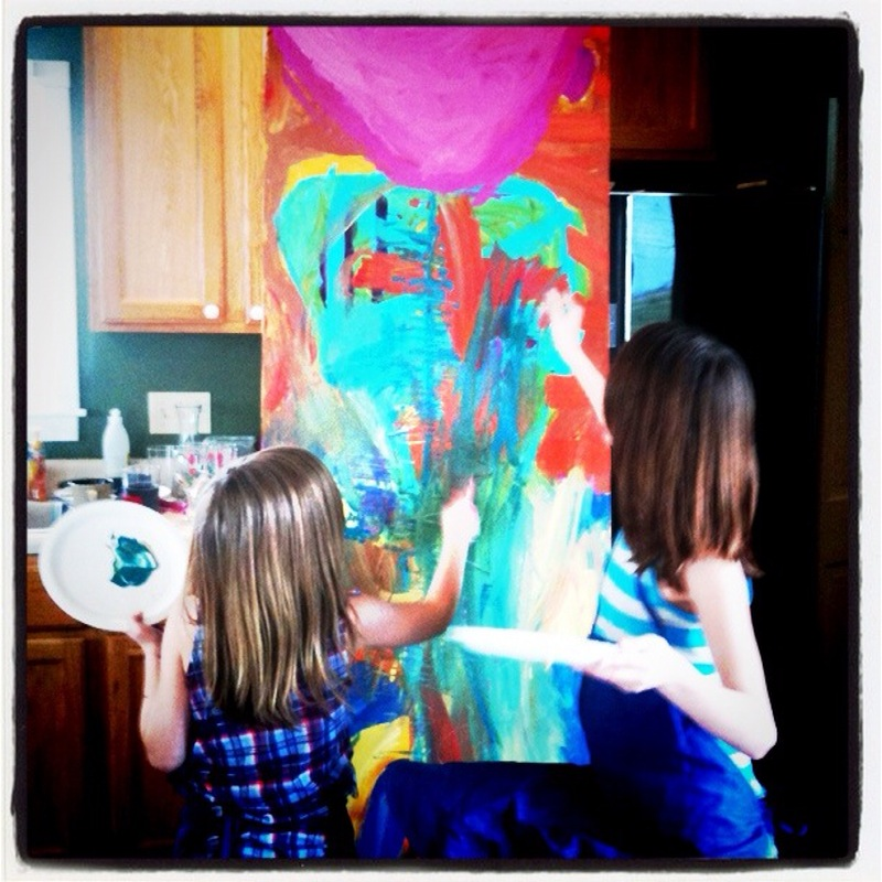 This canvas was built up over a few painting sessions.  It was large enough to collaborate on, which sparked creativity in both of the girls.