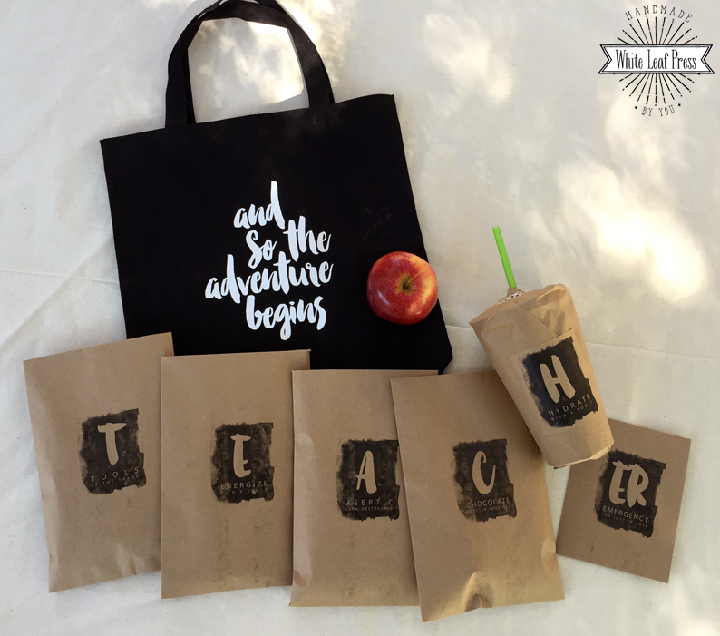 Canvas bag filled with little packages spelling out TEACHER.
