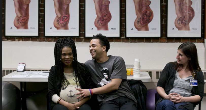Sherry Wilson and Tyrone Grandberry, who are expecting a girl, meet with fellow couples at Providence Maternal Care Clinic on East Burnside Street in Portland, February 10, 2015, for a weekly group. The couples receive support and information from staff including staff doula Kate Fricke, who address their concerns and check in on their overall well being. Beth Nakamura/Staff