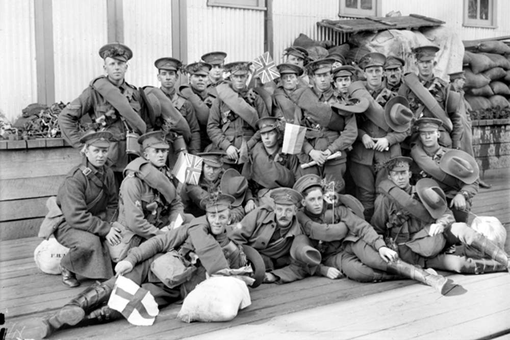 Port Melbourne , 1 August 1916 (WW1) . Members of the 18th Reinforcements, 1st Divisional Ammunition Column, informally grouped on the wharf, waiting to board the troopship HMAT Orsova (A67). Some of the soldiers have sprigs of wattle in their caps. Image courtesy of the Australian War Memorial.