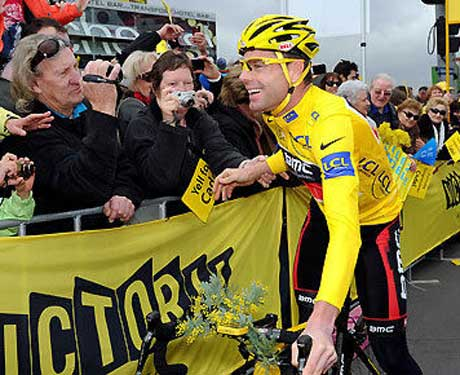 As cyclist Cadel Evans rode toward his 'Cadelebration' in Federation Square at Melbourne following his success in Le Tour de France 2011, he carried a small bunch of wattle on his handlebars. Photography by  Mal Fairclough