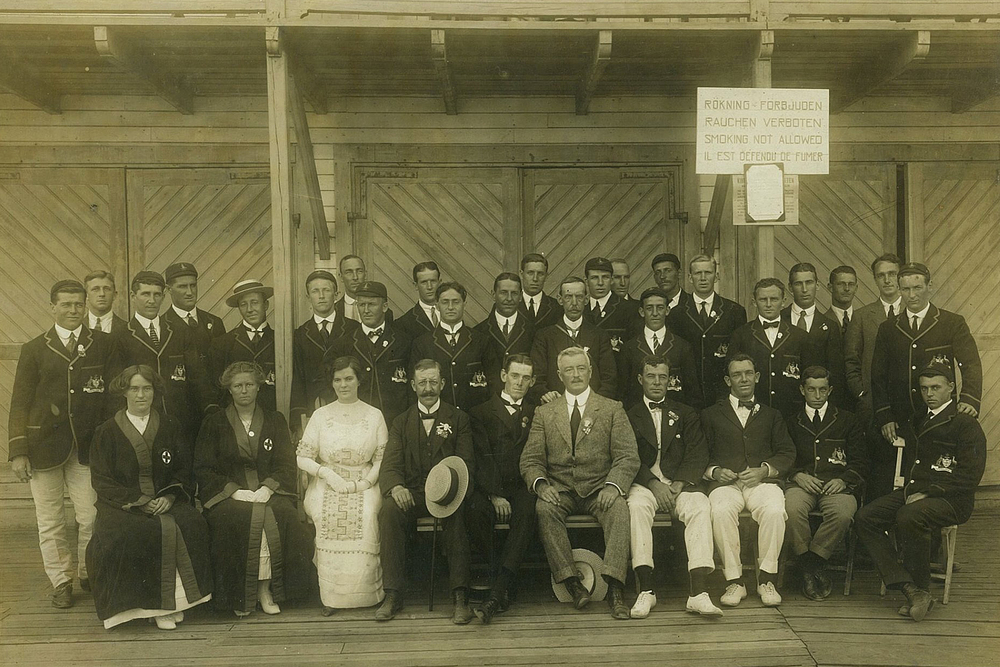 The Australasian (combined Australian and New Zealand) Olympic Team at Stockholm's Roddforening (Rowing Association), 1912. The first official Australian Olympic team to wear the green and gold. Image courtesy of the State Library of NSW.