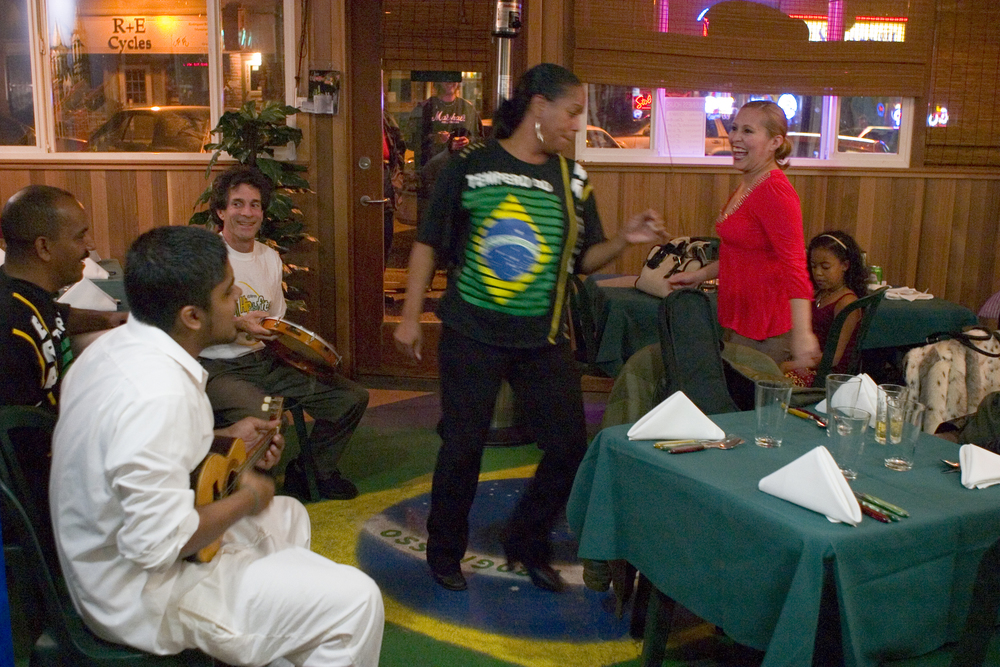 Graca and Nubia (Tempero's Cook) dancing samba at Tempero Do Brasil
