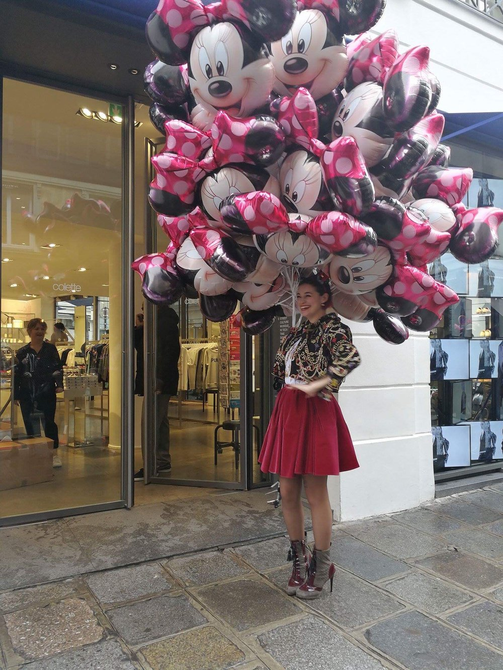 Marie Marquet in front of Colette with balloons