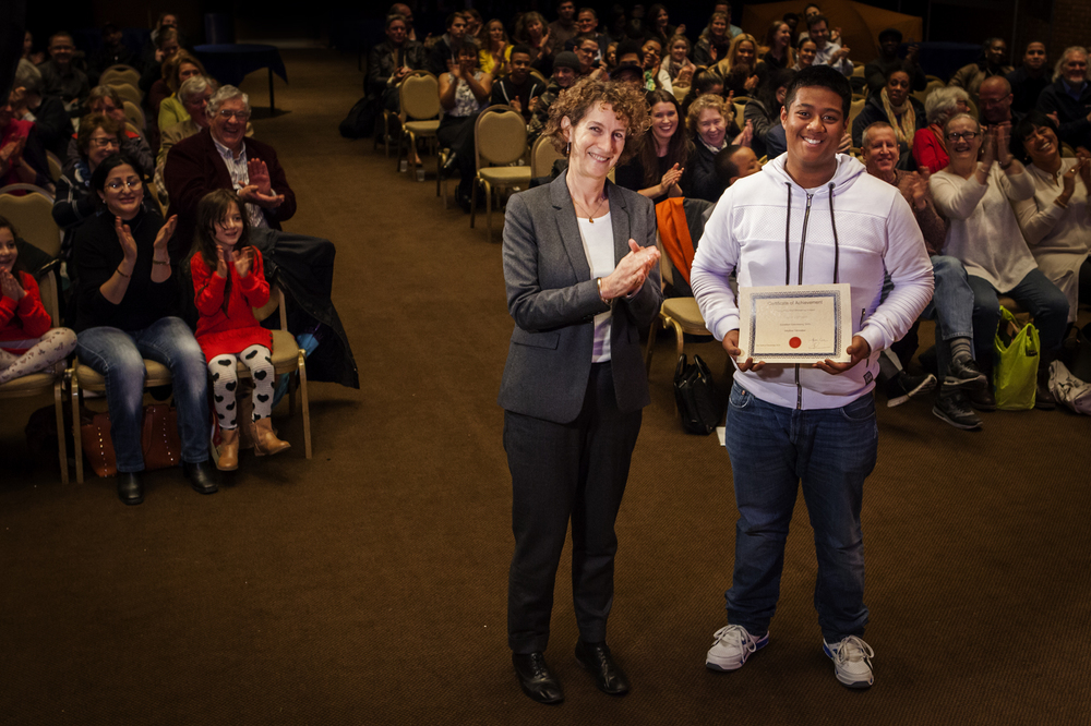 Abdul collecting his Certificate of Achievement from Clare Chamberlain, Director of Family Services, RBKC.