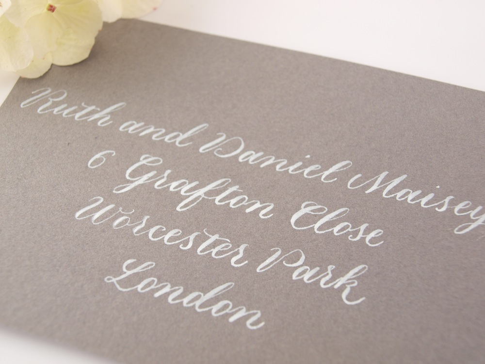white copperplate calligraphy on grey envelope.jpg