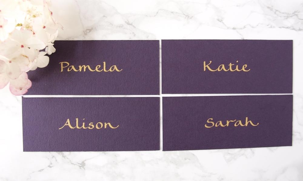 Purple place cards legende hand gold ink.jpg
