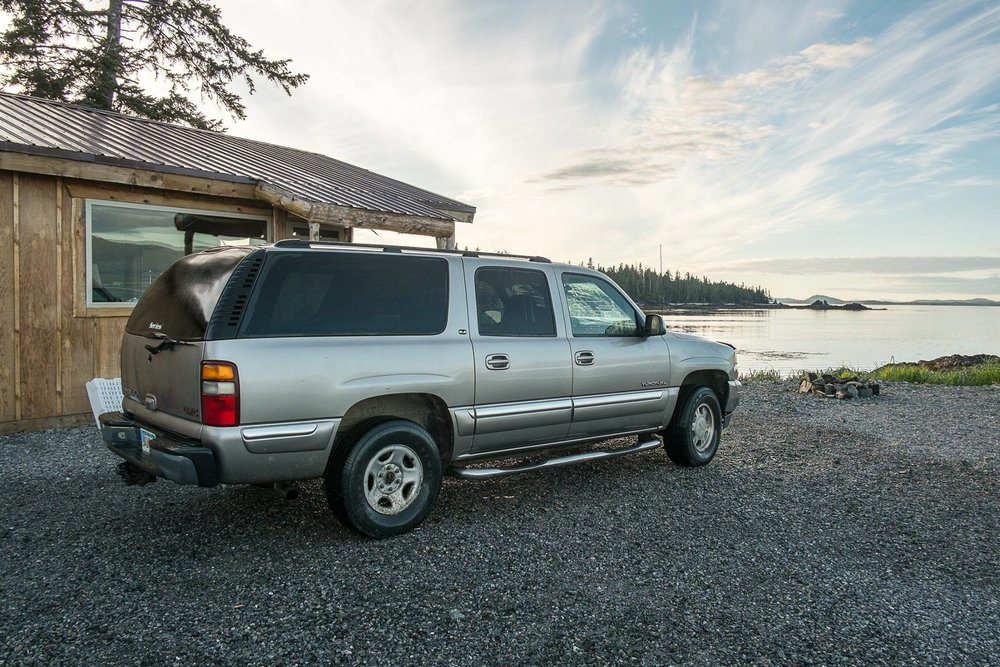 LOOKING AT THE VIEW FROM WHALE POINT CABI AND ONE OF THE CARS AVAILABLE FOR GUESTS TO LEASE. THE 260-MILE SCENIC BY-WAY, WILL BRING YOU THROUGH SOME BREATH-TAKING COUNTRY.  IMAGE: THE WHALE POINT CABIN, COFFMAN COVE,