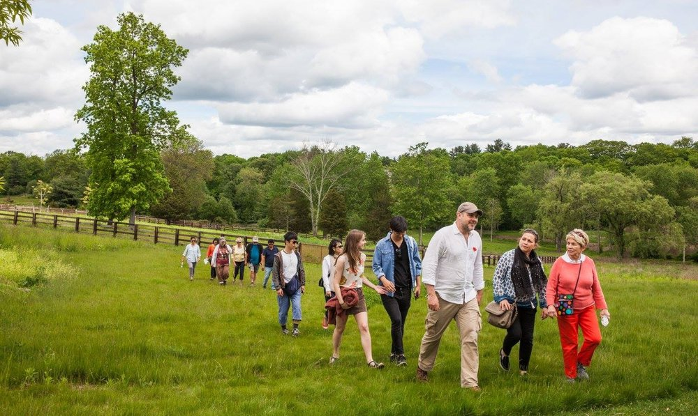THE FOCUS IS ON FAMILY AND NATURE AT GRACE FARMS. J. MARK FOWLER, NATURE INITIATIVE DIRECTOR, LEADS THIS EXPEDITION ON MEMORIAL DAY. IMAGE: VANESSA VAN RYZIN, THANKS TO GRACE FARMS.
